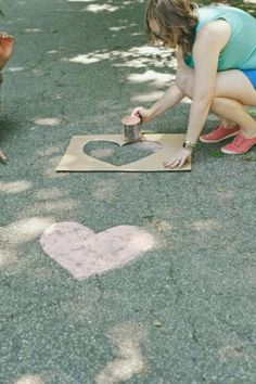 THIS! Teal arrows and gold hearts! please please please please   spray paint chalk that comes off when it rains add stencil and do this to the road leading up and around the house