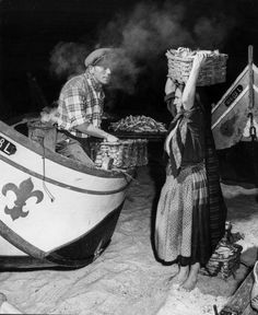 A fisherman and woman sell fresh fish from their boat in Nazare a Portuguese fishing village Catfish Fishing, Fly Fishing, Fishing In The Bahamas, Two Spirit, Bahamas Island, Fishing Photography, Visit Portugal, Canoe Trip, Used Boats