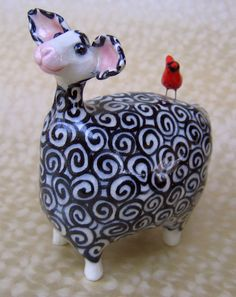 Black and White Ceramic Sheep with Cardinal by Karen Fincannon; a-HA!  This makes me smile