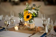 A rich array of textures including flowers, burlap, lace and wood grain create a beautiful centerpiece at a Historic Barns of Nipmoose wedding. Eyes Wide Shutter Photography