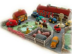 Crochet Soft Toys Little Knittington Toy Village - This lovely knitted village is the work of Georgina Manvell who created it for the Home Crochet Hook Set, Crochet Toys, Crochet Animals, Knitting Patterns Boys, Crochet Patterns, Doll Patterns, Red Lion Pub, New Girl, Boy Or Girl
