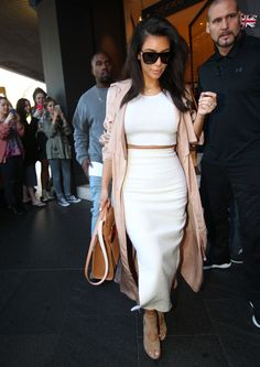 September 14 2014 | She's got the look! Kim's pastel coat was the perfect complement to her stark white dress and beige heels