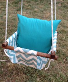 Bushy Tails Baby Swing Pillow-Custom on Etsy, $50.00 like the navy chevron pattern or a light grey pattern