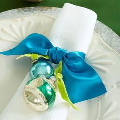simple ribbons and vintage ornaments. This would be cute with names on them for place settings!!!!