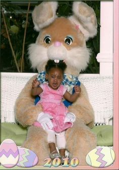Is it just me or does it look like the Easter bunny is trying to eat this poor little girl?