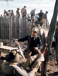 THE ALAMO (1960) - Director John Wayne discusses an upcoming shot with Oscar-winning director John Ford (foreground) on the set near Brackettville, TX - Produced & Directed by John Wayne - United Artists - Production Still.
