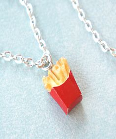 This necklace features a handmade french fries charm sculpted from polymer clay. It measures approx. 1 cm x cm and is securely attached to a silver tone chain necklace that measures 24 inches in l Cute Necklace, Cool Necklaces, Cute Bracelets, French Fries, Mother Gifts, Polymer Clay, Jewelery, Jewelry Accessories, Miniatures