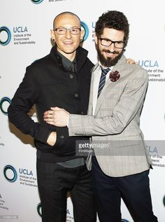 Chester Bennington (L) and Brad Delson of Linkin Park arrive at An Evening of Environmental Excellence presented by the UCLA Institute of The Environment and Sustainability held at a private residence on March 21, 2014 in Beverly Hills, California.
