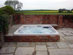 inground hot tub, half in the ground