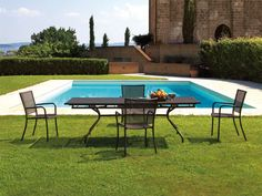Contemporary round garden table (metal) - CAMBI by Aldo Ciabatti - EMU
