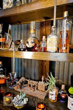 Arrowood Photography, Decor by Asiel Designs: rustic old world hip airplants steampunk metal wood industrial alchemist bar