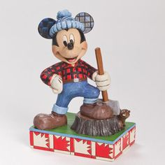 Greetings and Bon Jour from Canada. Mickey Mouse is on a world tour and makes his stop north of the border for a real northern adventure and befriends the national animal... the beaver. The base represents the Canadian flag in red & white. Figurine 6 in H