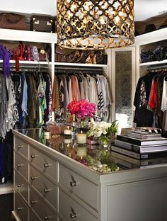 Island in the center of my walk-in closet with drawers set up like Victoria Secrets store!