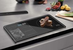 """A concept kitchen """"tablet"""" that functions as a cutting board, cookbook, and scale."""