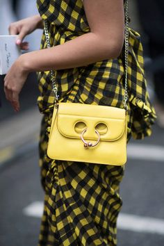 A guest seen wearing a Chloe bag before the Chloe Fashion Show in the streets of Paris during the Paris Fashion Week on September 28 2017 in Paris...
