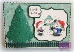 Crafter's Companion; Party Paws Christmas Stamp.  spectrum Noir pens Dr2,3 IG 2,3,6,8,10, TB3,4 BT,3,4,BP 1,3, TN6 Watercolour card,  Colorcore card Gems Glitterglue Pearly doodles Diesire dies, O Christmas tree & picket fence Collall All purpose glue & decoupage glue