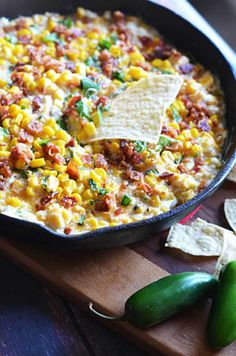 Cheesy Bacon Jalapeno Corn Dip.  The sprinkle of basil seems weird but it's so amazing.  This is a new football sunday must-have.  Game day appetizer at its finest!    hostthetoast.com