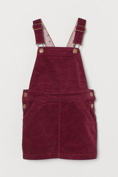 Bib overall dress in soft cotton corduroy. Adjustable suspenders, front and back pockets, and snap fasteners at sides. Lined at top. Dungaree Dress, Dungarees, Cute Overalls, Corduroy Overall Dress, Baby Boy, Leggings, Powder Pink, Fashion Company, Suspenders