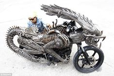 Alien motorcycle Mean machine: A worker checks the intricate metal finishing on this monster motorcycle which has been made from spare parts from cars and bicycles