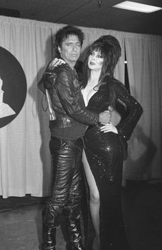 Alice Cooper and Elvira. He looks thrilled, she (as always) looks amazing.