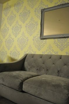 Ornamental Cartouche damask stencil on walls with a  yellow and gray color combo. Great vintage/modern look!