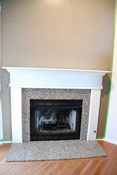 fireplace makeover with verde marble covered by mosaic tile