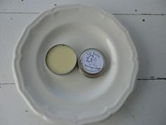 """Sunflower oil, beeswax, local honey, lanolin, vitamin E and a Honeysuckle/Nectarine flavor oil is hand mixed and poured by me.   While most of the honey is incorporated into the oil, sometimes you'll see a honey droplet.  """"Hey Sweet Lips"""", could be you.  This balm goes on soft and creamy, not hard and waxy."""