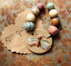 Flutter. Handmade ceramic butterfly pendant and bead set. Gaea handmade ceramic design elements and adornments! | gaea.cc