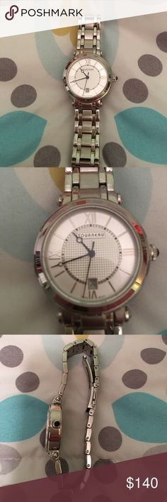 Woman's Tourneau watch Silver Tourneau linked watch, no links have been removed. A few scuffs on the clasp but no other signs of wear, worn twice. Will need new battery. Tourneau Jewelry