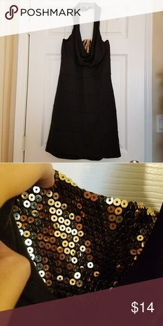 Black halter dress with peek a boo gold sequins LBD from BONGO with gold peek a boo sequins. New, never worn, with the tag still on. In perfect condition. I am willing to accept any reasonable offer ^.^ BONGO Dresses