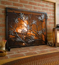 This beautifully detailed Golden Oak Fireplace Screen features graceful metal oak branches and embossed leaves, studded with charming tempered glass acorns. You'll love how the flames highlight the amber glass and copper distressing on the leaves. This flat guard screen is gorgeous with wood or gas fireplaces.