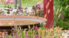 Rusted circular water feature in the APL Garden at Hampton Court Palace Flower Show A Place to Meet Hampton Court Flower Show, Rhs Hampton Court, Annual Flowers, Chelsea Flower Show, Water Features, Bird Feeders, Palace, Garden Design, Summertime