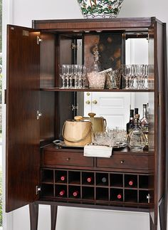 The Paris Bar Cabinet is a unique piece that echoes the early Art Deco style. Made of beautiful mahogany, it features custom hardware on the two doors, which open to reveal storage space for wine, glasses or other accessories.