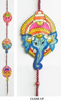 Hand Painted Hanging Ganesha Faces with Beads - Perforated Leather Crafts from Andhra Pradesh (Leather))