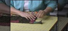 "Here's a new way to look at making perfect mitered corners the first time, every time. This instructional quilting video demonstrates how to sew consistent mitered corners on your quilts in a few steps. Use a ""Minute Miter"" tool to hold the fabric in place. Learn why this seamstress says, ""no snouts allowed."""