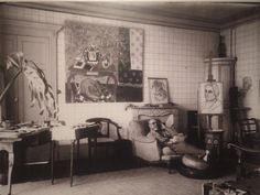 "Matisse in his Nice, France studio with ""Interior with Dog"" and portraits of Etta Cone, c. 1934.  Archival Photograph.   Matisse, Life In Color: Masterworks from The Baltimore Museum of Art, San Antonio Museum of Art : 14 June - 7 September 2014."