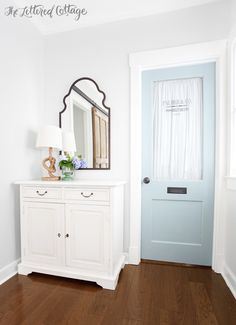 Ballard Designs Lungarno Console | Grandin Road Arched Mirror | Land of Nod Rope Lamp | Old Blue Office Door | Cottage Decorating