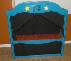 """And this is the """"After"""", a beautiful Puppet Theatre for kids of all ages.  Complete with wood floor stage, black curtains with pull backs, open top for marionette puppets and the bottom curtain area can be used for puppet storage or little feet while putting on a show.  The top front features hand painted theatre masks and shimmery yellow gold wood stars."""