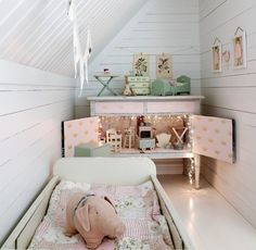 dollhouse in a cabinet with twinkle lights Cute! (I also like the shape of this little room :3)