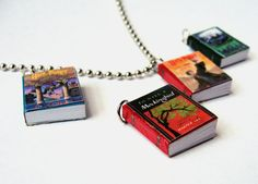 Miniature Book Pendants customized by Etsy Artist. Those pictures include Harry Potter and the Sorcerer's Stone, To Kill a Mocking Bird, and Harry Potter and the Deathly Hallows.