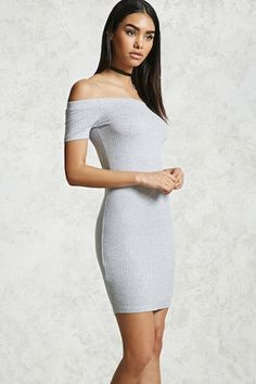 An off-the-shoulder ribbed knit bodycon dress featuring short sleeves and an elasticized neckline.