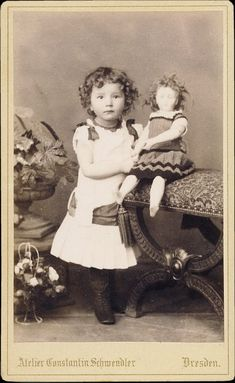 Sweet antique portrait of little girl with her doll. Circa 1880 - 1890?