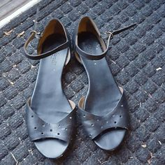 Madewell Black Holepunch Sandals These sandals are very comfortable and cute! They have little holepunches in the piece that goes across your foot with gold closure details around the ankle. All leather with exception of sole. Madewell Shoes Sandals