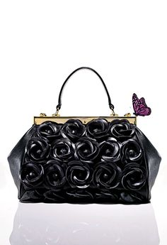 Sneak Peek: Sweet and wicked? Yes, with this Clever Carriage Flower Satchel in the spirit of Maleficent. (Available 5/7/14 on HSN.com)