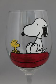 A Snoopy and Woodstock wine glass