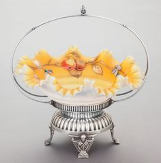 Silver Holloware, American, A MERIDEN SILVER-PLATED STAND WITH ENAMELED GLASS BOWL. MeridenSilver Plate Co., Meriden, Connecticut, circa 1900.
