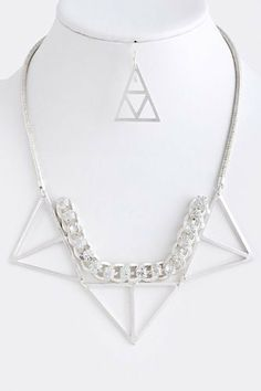 "Silver Collar Geometric-Pyramid Statement Necklace - Silver Crystal Chain Lined Triangle Necklace StarShine Jewelry. $20.80. Lead compliant. Crystal chain lined triangle necklace. Length approx 20"". Lobster claw clasp with 3"" extender"