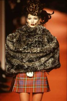 A history of Fashion Week. #fashion #FashionWeek #VivienneWestwood #catwalk (Image: Vivienne Westwood Autumn/Winter 1993/94, photograph by Niall McInerney, Bloomsbury Fashion Photography Archive)