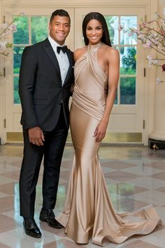 RUSSELL WILSON AND CIARA Russell Wilson, National Football League (NFL) quarterback for the Seattle Seahawks and singer Ciara Harris arrive at a state dinner hosted by U.S. President Barack Obama and U.S. First Lady Michelle Obama in honor of Japan's Prime Minister Shinzo Abe at the White House in Washington, D.C., U.S.