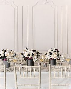 Punch up white floral centerpieces with blooms so dark they're almost black